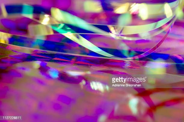 metallic foil ribbons, pink and silver and purple - リフレクター ストックフォトと画像