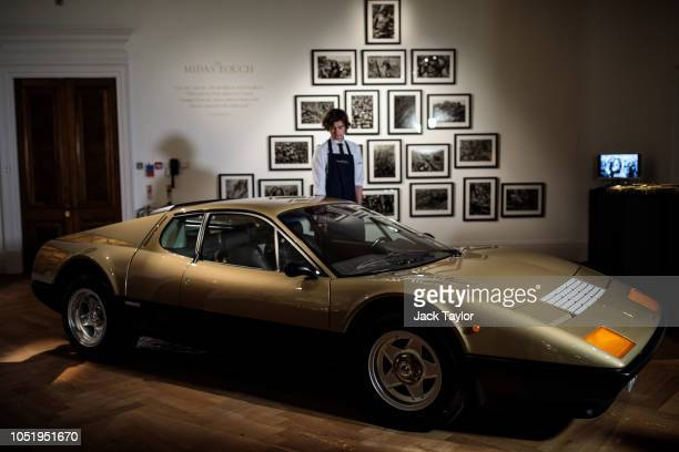 A metallic gold 1977 Ferrari 512 BB sits on display during a media preview at Sotheby's auction house for their 'Midas Touch' auction on October 12...
