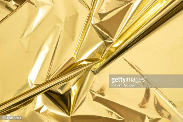 metallic gold mylar paper texture background - wrapped stock pictures, royalty-free photos & images