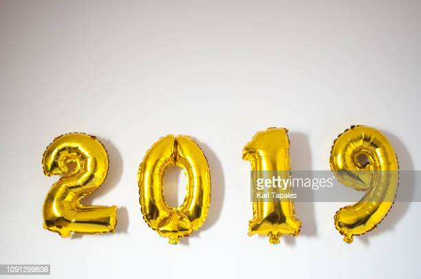 2019 metallic gold-colored inflatable balloon - 2019 stock pictures, royalty-free photos & images