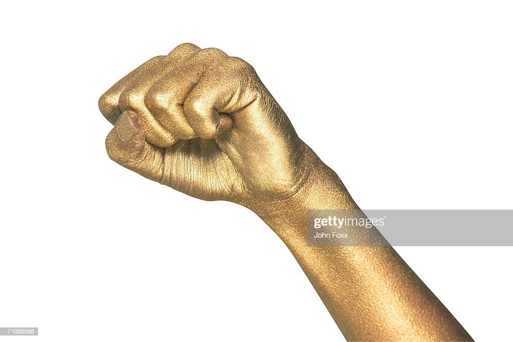 metallic hand making a fist : Stock Photo