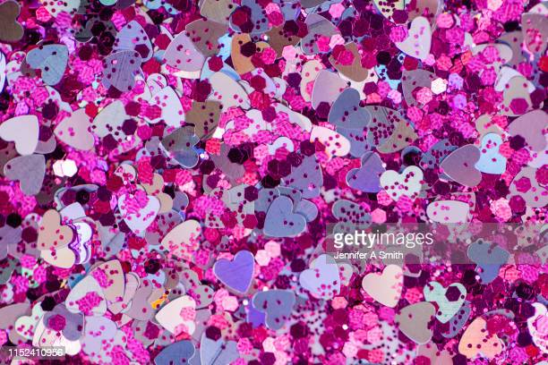 metallic heart sprinkles - pink sparkles stock pictures, royalty-free photos & images