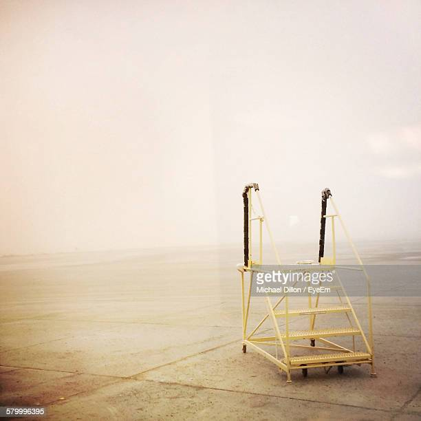 metallic ladder on empty tri-cities regional airport runway under foggy weather - pasco stock photos and pictures