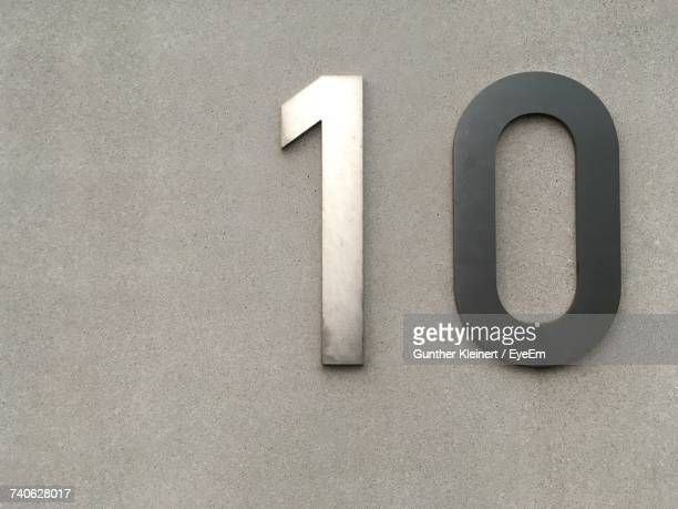 Metallic Number 10 On Concrete Wall