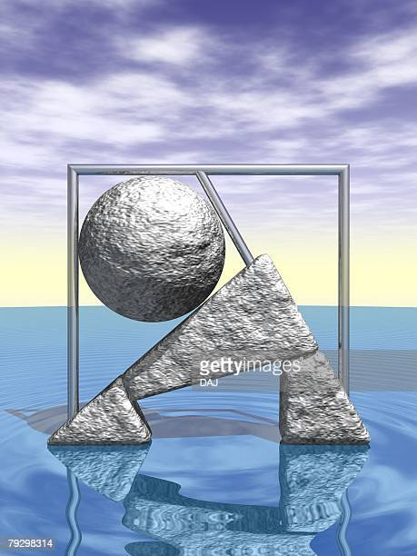 Metallic objects in various shapes on water surface