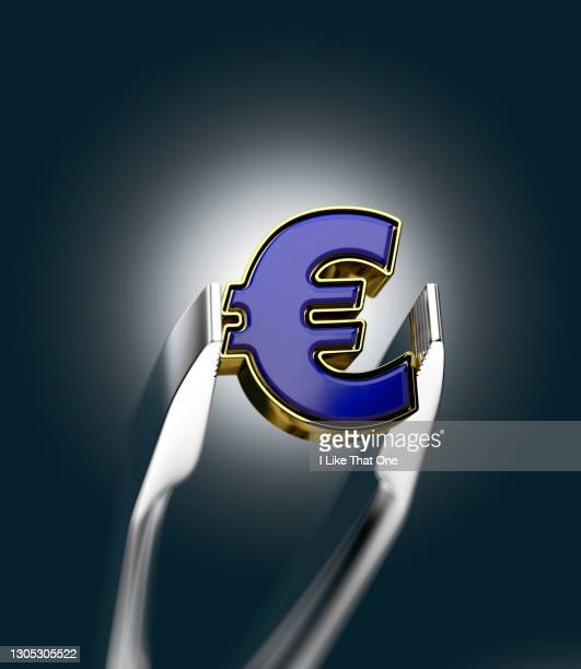 a metallic pair of tweezers hold a euro symbol - atomic imagery stock pictures, royalty-free photos & images