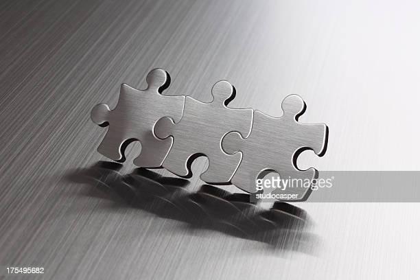 metallic peças de quebra-cabeça - três objetos - fotografias e filmes do acervo