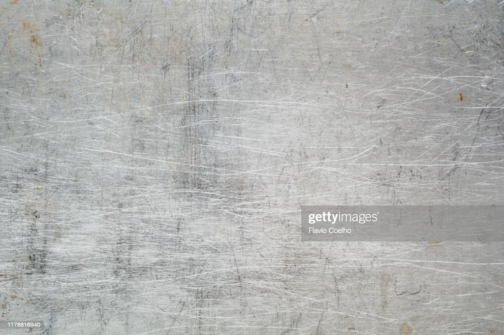 Metallic surface scratched and stained : Stock Photo