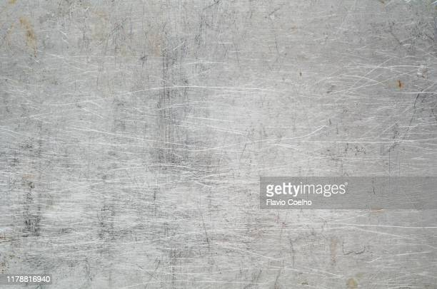 metallic surface scratched and stained - full frame stock pictures, royalty-free photos & images