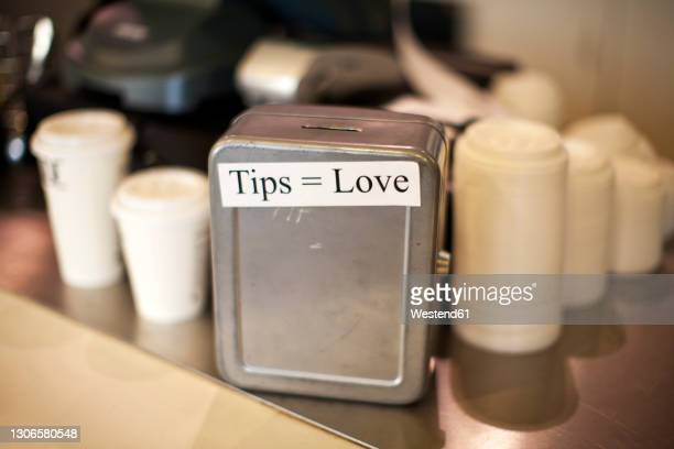 metallic tips box at cafe - western script stock pictures, royalty-free photos & images