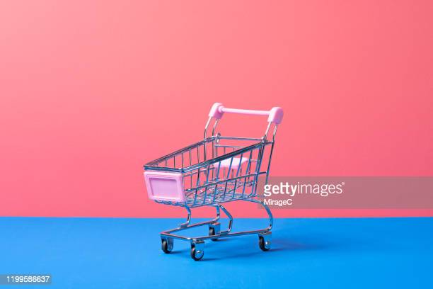 metallic toy shopping cart - farbquadrat stock-fotos und bilder