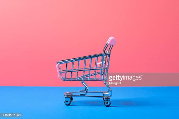 metallic toy shopping cart - colour block stock pictures, royalty-free photos & images