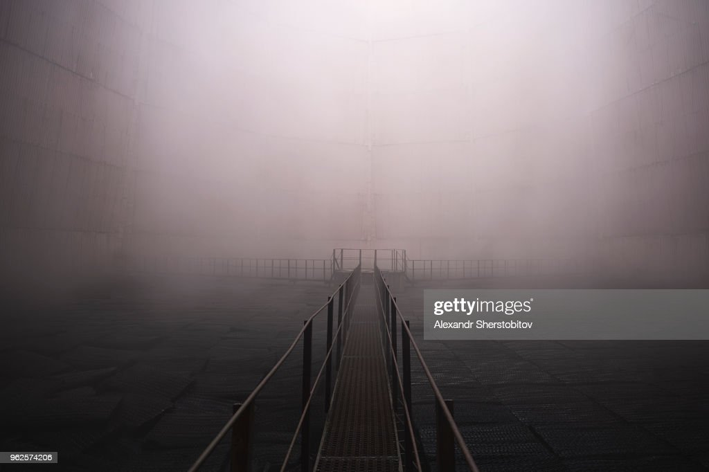 Metallic walkway in foggy weather : Stock Photo