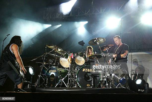 Metallica perform with substitute drummer Dave Lombardo from Slayer on stage at day two of the Download Festival at Donington Park on June 6 2004 in...