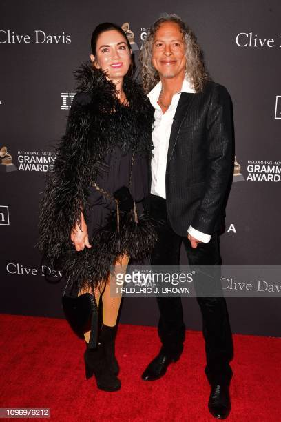 Metallica's lead guitarrist US musician Kirk Hammett and Lani Hammett arrive for the traditional Clive Davis party on the eve of the 61th Annual...