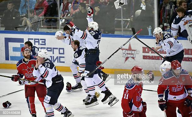 Metallurg Magnitogorsk team members celebrate after winning the final match against CSKA team during the seventh game of the Kontinental Hockey...