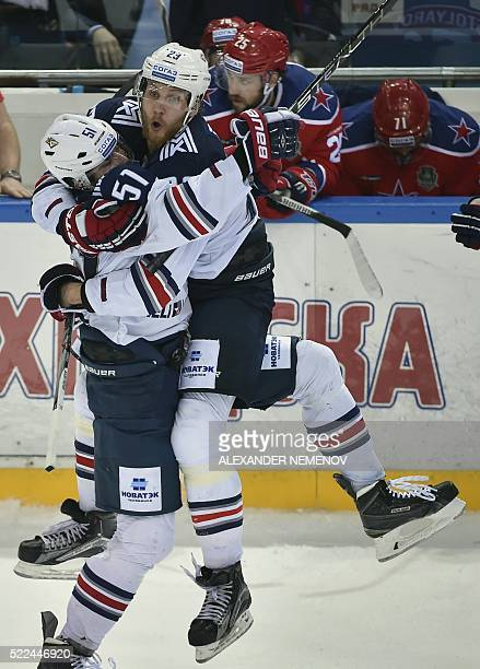Metallurg Magnitogorsk's Alexey Bereglazov and Yevgeny Timkin celebrate a goal during the seventh game of the Kontinental Hockey League final at the...