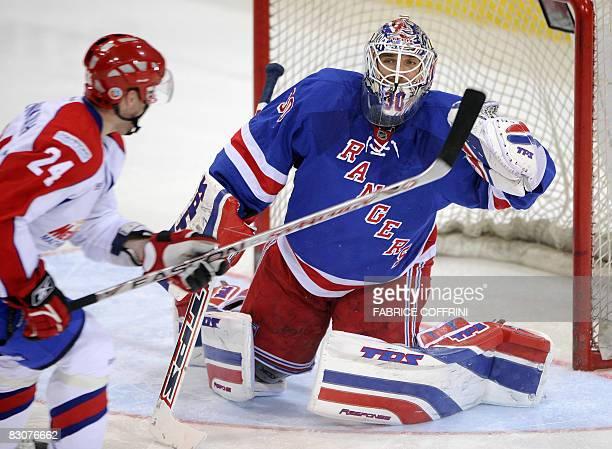 Metallurg Magnitogorsk's Vladimir Malenkikh challlenges New York Rangers goalkeeper Henrik Lundqvist during the first ever Victoria Cup game on...