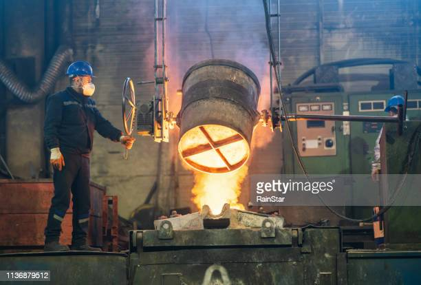 metallurgical plant, hot metal casting - mining stock pictures, royalty-free photos & images