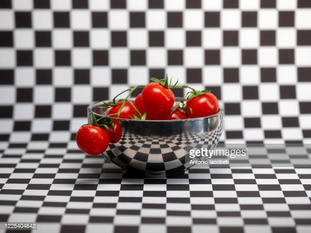 metaphysical tomato - esher stock pictures, royalty-free photos & images