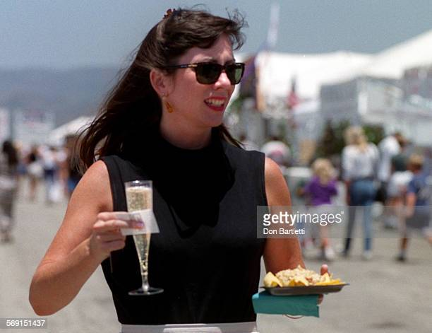 """METasteChampagneDB6/21/97ElToro Susan Henry of Glendale walks along the midway at the """"Taste Of Orange County"""" food fair Saturday afternoon with..."""
