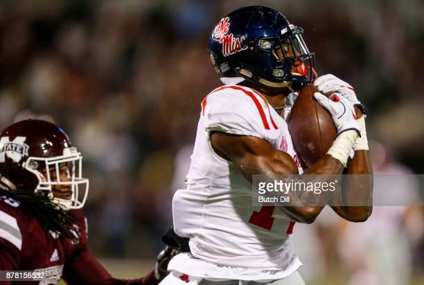 K Metcalf of the Mississippi Rebels catches a pass as Lashard Durr of the Mississippi State Bulldogs tries to defend during the second half of an...