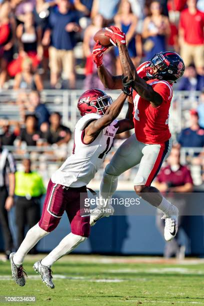 K Metcalf of the Mississippi Rebels catches a pass over Torian Lewis of the Southern Illinois Salukis at VaughtHemingway Stadium on September 8 2018...
