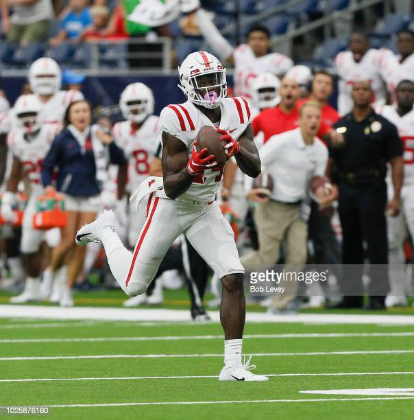 K Metcalf of the Mississippi Rebels runs for a 58 yard score after making the catch in the first quarter against the Texas Tech Red Raiders at NRG...