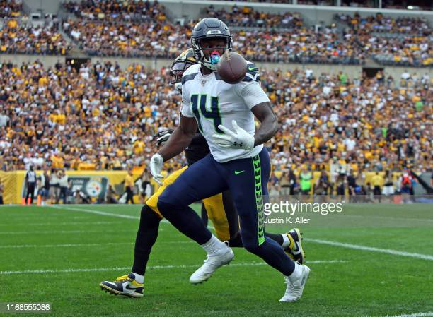 K Metcalf of the Seattle Seahawks catches a 28 yard touchdown pass in the fourth quarter against the Pittsburgh Steelers on September 15 2019 at...