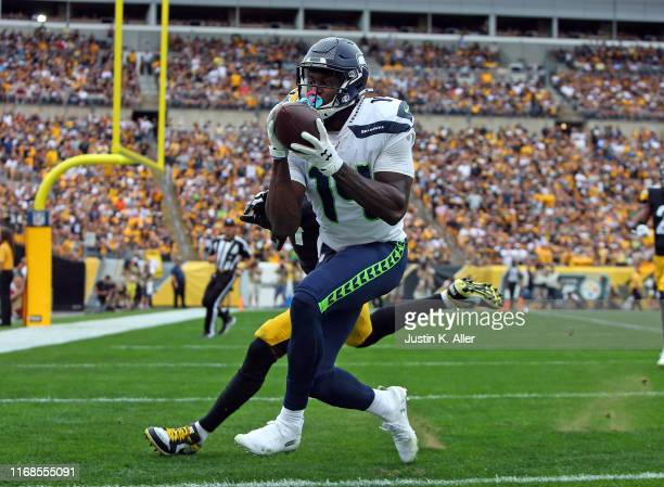 K Metcalf of the Seattle Seahawks catches a 28yard touchdown pass in the fourth quarter against the Pittsburgh Steelers on September 15 2019 at Heinz...