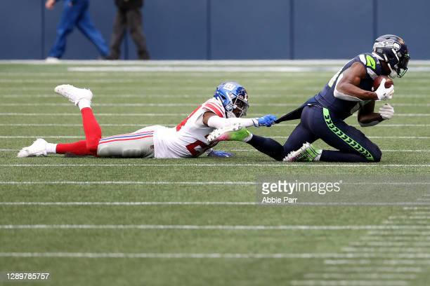 Metcalf of the Seattle Seahawks catches a pass against James Bradberry of the New York Giants during the second quarter in the game at Lumen Field on...
