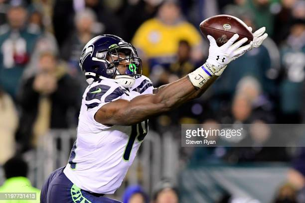 Metcalf of the Seattle Seahawks catches a pass for a touchdown in the third quarter of the NFC Wild Card Playoff game against the Philadelphia Eagles...