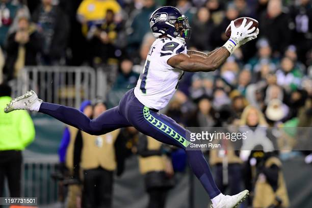 K Metcalf of the Seattle Seahawks catches a pass for a touchdown in the third quarter of the NFC Wild Card Playoff game against the Philadelphia...