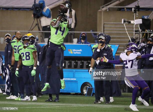 Metcalf of the Seattle Seahawks catches a pass on fourth down during the fourth quarter against Cameron Dantzler of the Minnesota Vikings at...