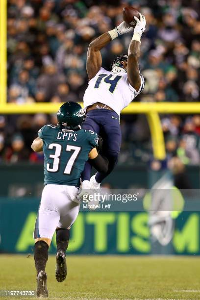 K Metcalf of the Seattle Seahawks catches a pass over Marcus Epps of the Philadelphia Eagles in the fourth quarter of the NFC Wild Card Playoff game...