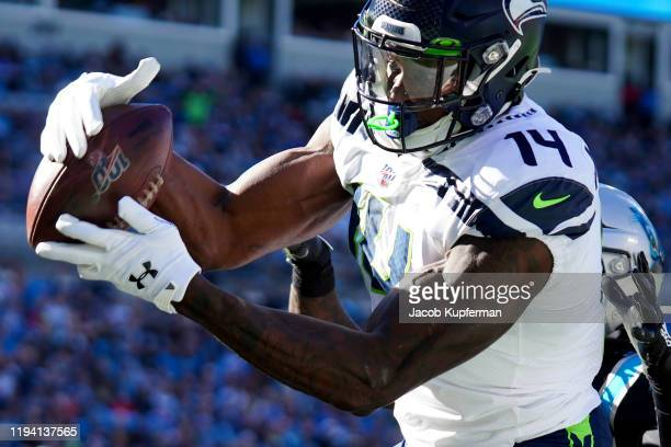 K Metcalf of the Seattle Seahawks catches a touchdown pass during the first quarter during their game against the Carolina Panthers at Bank of...