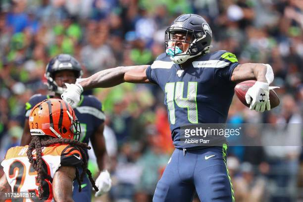 K Metcalf of the Seattle Seahawks celebrates after making a catch in the third quarter against the Cincinnati Bengals during their game at...
