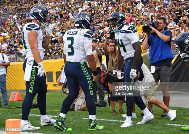 K Metcalf of the Seattle Seahawks celebrates his touchdown with Russell Wilson during the fourth quarter against the Pittsburgh Steelers at Heinz...