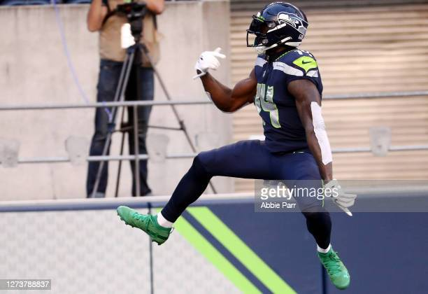 Metcalf of the Seattle Seahawks celebrates scoring a second quarter touchdown against the New England Patriots at CenturyLink Field on September 20...
