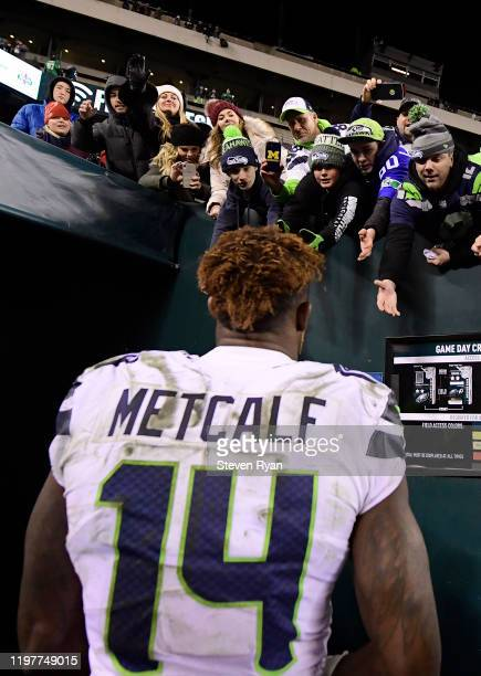 K Metcalf of the Seattle Seahawks celebrates with fans after winning the NFC Wild Card Playoff game 179 over the Philadelphia Eagle at Lincoln...