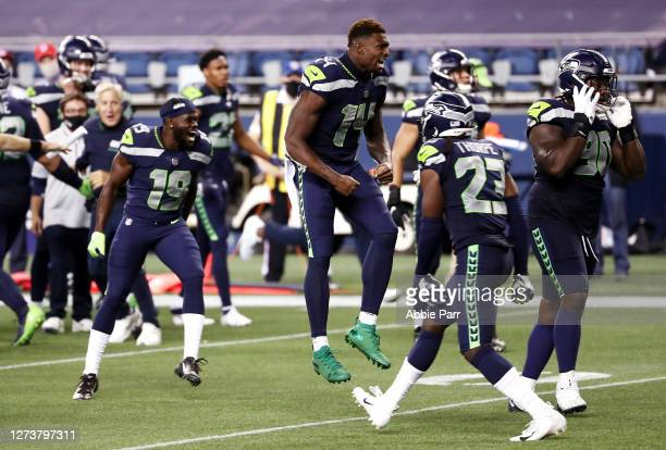 Metcalf of the Seattle Seahawks celebrates with teammates after defeating the New England Patriots 35-30 at CenturyLink Field on September 20, 2020...