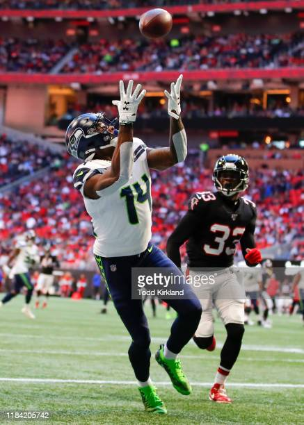 K Metcalf of the Seattle Seahawks dives for the ball which is then ruled incomplete in the first half of an NFL game against the Atlanta Falcons at...