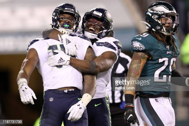 K Metcalf of the Seattle Seahawks is congratulated by David Moore after making a reception for a touchdown against the Philadelphia Eagles in the...