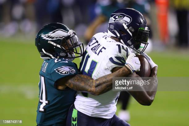 Metcalf of the Seattle Seahawks is tackled by Darius Slay of the Philadelphia Eagles during the second quarter at Lincoln Financial Field on November...