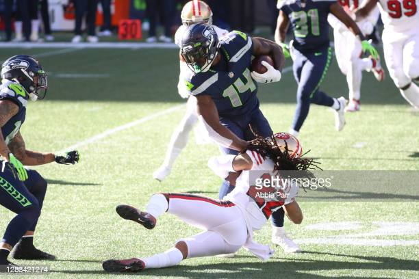 Metcalf of the Seattle Seahawks is tackled by Jason Verrett of the San Francisco 49ers the first quarter at CenturyLink Field on November 01 2020 in...
