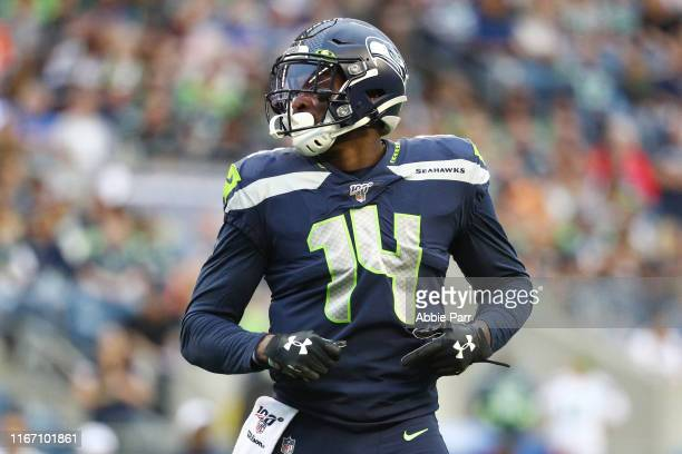 K Metcalf of the Seattle Seahawks looks on against the Denver Broncos in the fourth quarter during their preseason game at CenturyLink Field on...