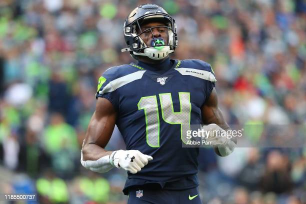 K Metcalf of the Seattle Seahawks looks on against the Tampa Bay Buccaneers in the third quarter during their game at CenturyLink Field on November...