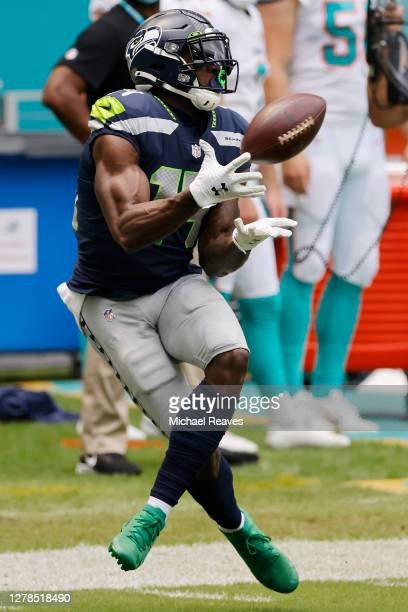 Metcalf of the Seattle Seahawks makes a catch against the Miami Dolphins during the first half at Hard Rock Stadium on October 04 2020 in Miami...