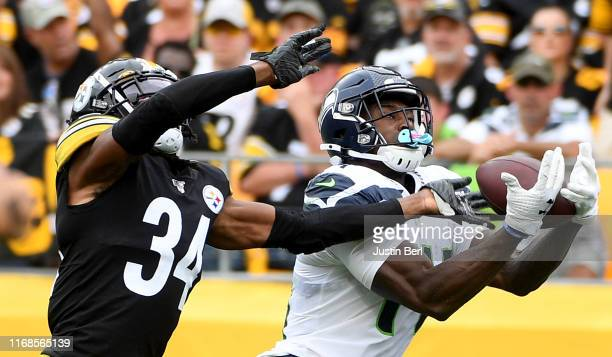K Metcalf of the Seattle Seahawks makes a catch for a 28yard touchdown as Terrell Edmunds of the Pittsburgh Steelers defends in the fourth quarter...