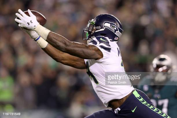 K Metcalf of the Seattle Seahawks makes a reception for a touchdown against the Philadelphia Eagles in the third quarter during their NFC Wild Card...